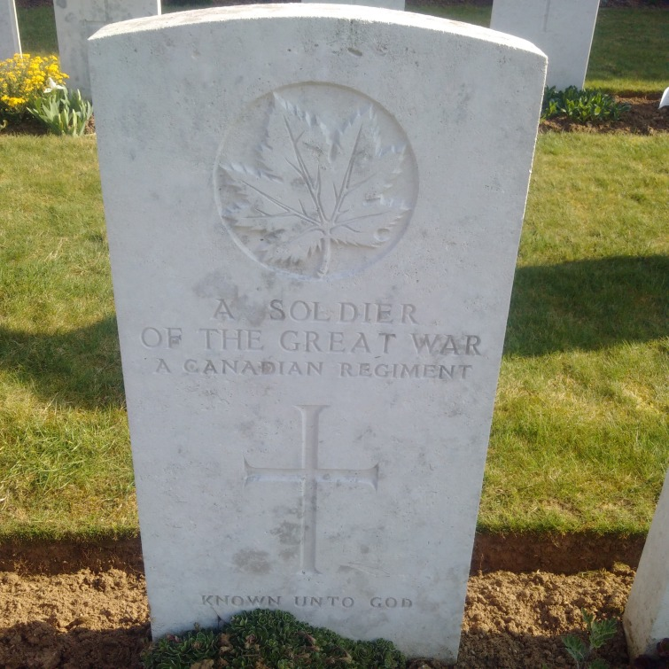 "A gravestone from a Commonwealth cemetery in France, engraved with ""a soldier of the great war, a Canadian regiment, known unto God"""