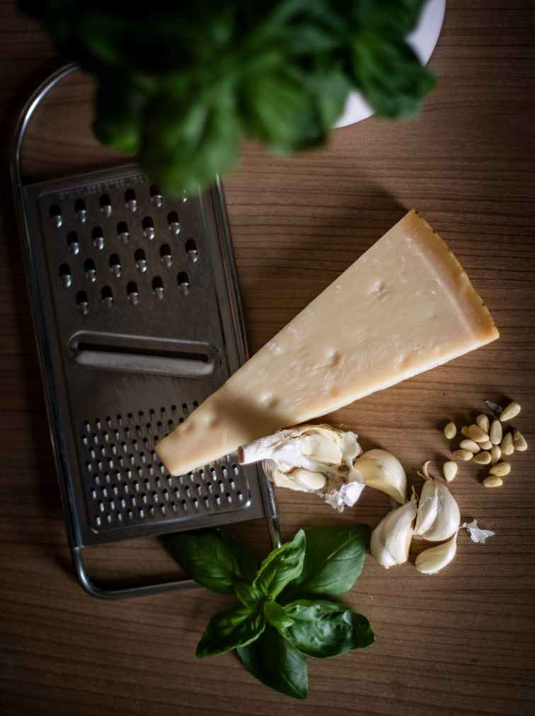 Cheese grater and ingredients for pesto