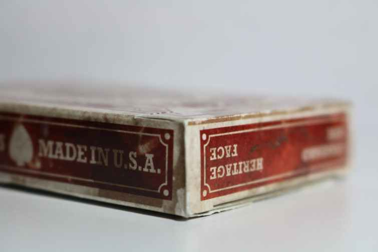 close up photography of dirty playing card box