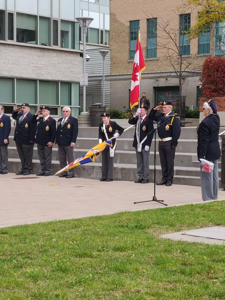 The Royal canadian Legion flag party lowers the colours during Last Post at the Poppy Flag Raising ceremony