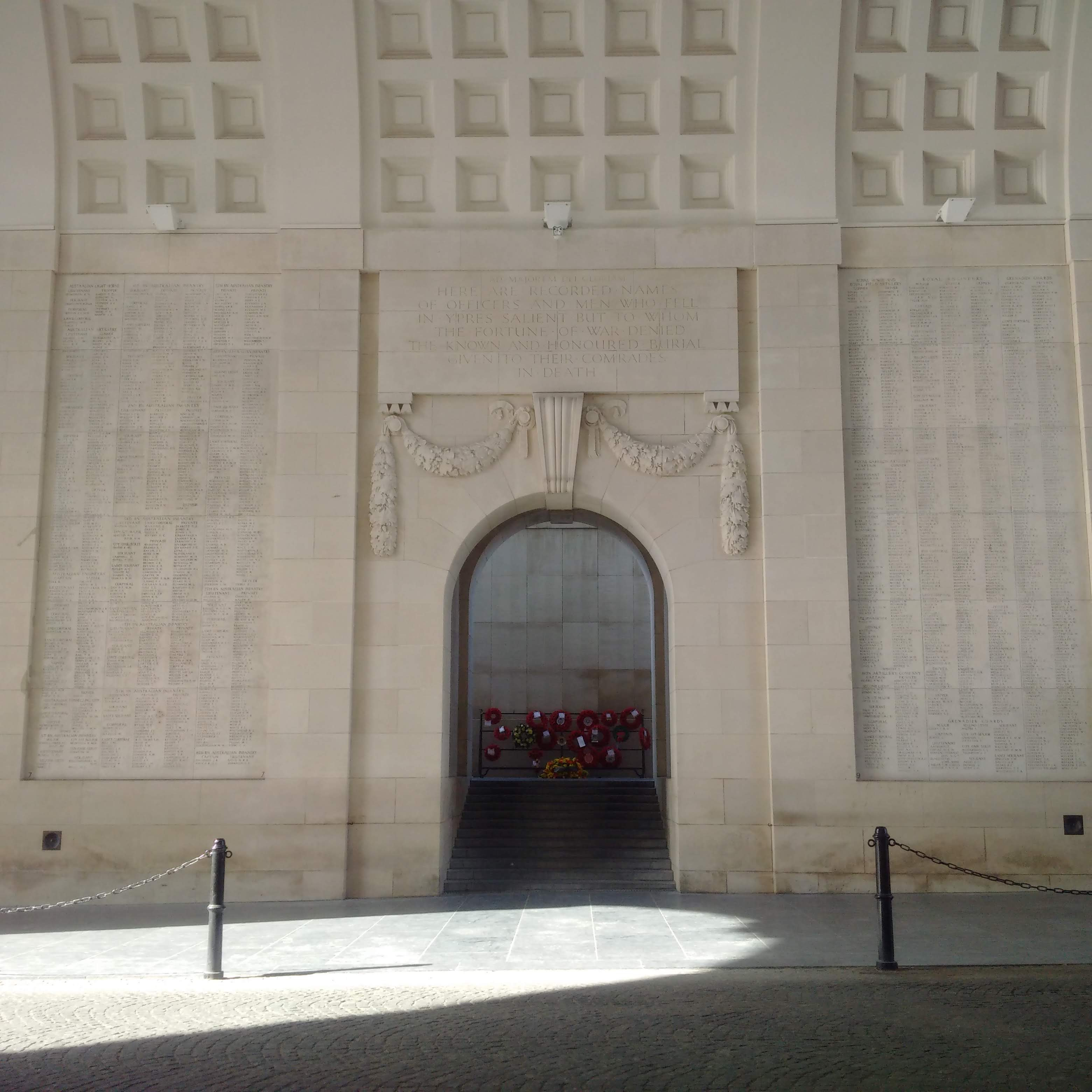 Wreathes laid at the Last Post Ceremony at the Menin Gate in Ypres, viewed through the archway inside the gate