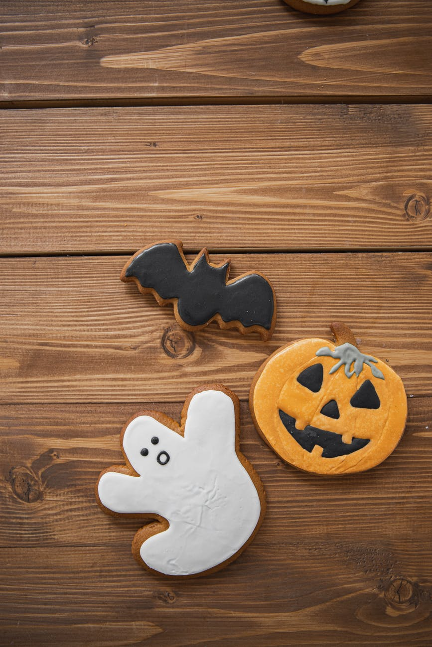cookies cut in the shape of a bat, ghost, and jack'o'lantern.