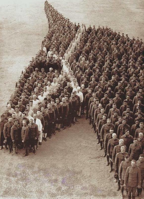 Men standing in a formation that appears to be a horses head to represent the horses conscripted into the war effort.